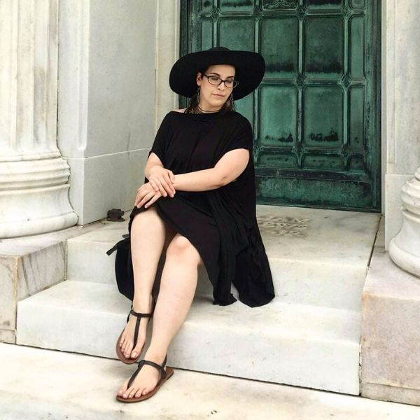 Michelle on steps with black dress and hat